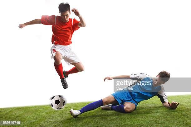 close-up of soccer players - tackling imagens e fotografias de stock