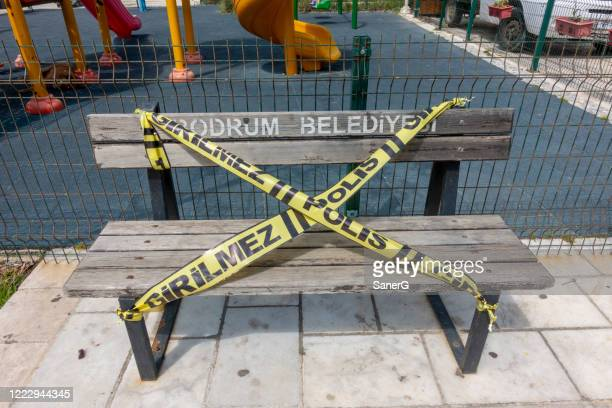 close-up of social distancing warming sign in a bench park in bodrum - mugla province stock pictures, royalty-free photos & images