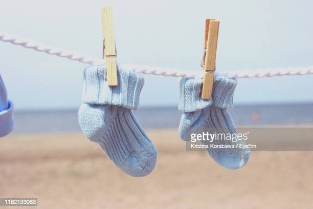 close-up of socks hanging on rope - clothespin stock pictures, royalty-free photos & images