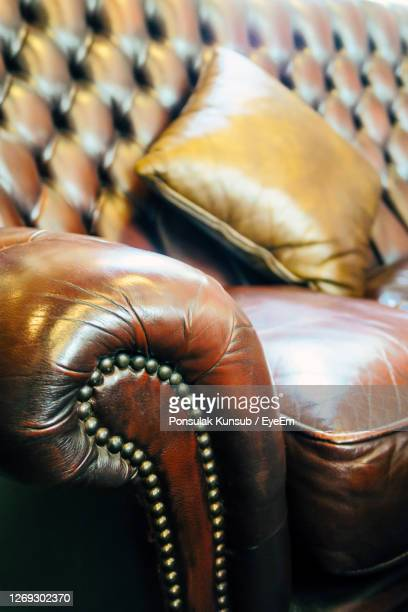 close-up of sofa at home - leather stock pictures, royalty-free photos & images