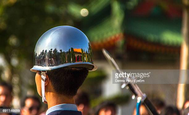 close-up of soldier wearing helmet with reflection during parade on sunny day - military parade stock pictures, royalty-free photos & images