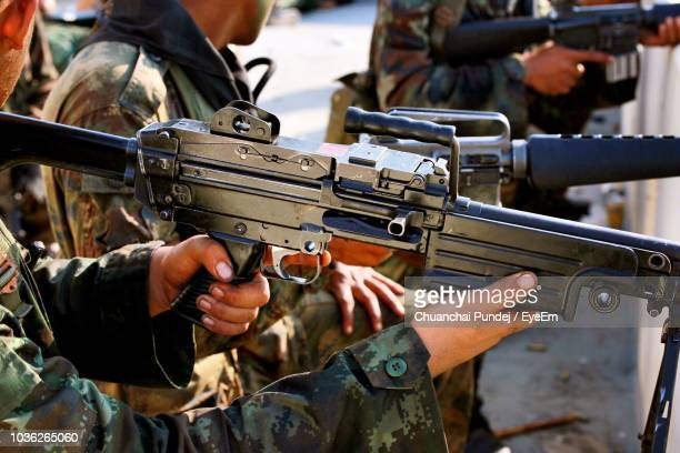 close-up of soldiers holding guns - machine gun stock pictures, royalty-free photos & images