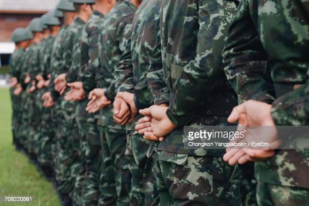 close-up of soldiers in a row - army soldier stock photos and pictures