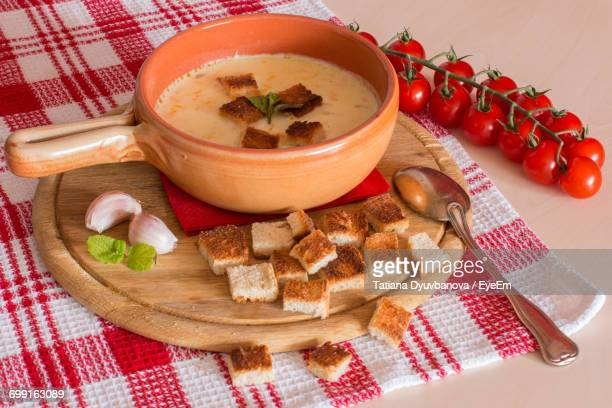 close-up of soup and vegetables on table - crouton stock photos and pictures