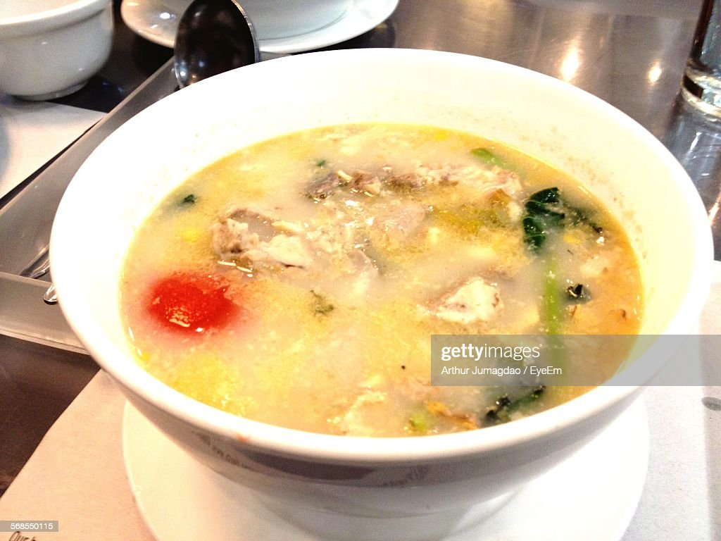 Close-Up Of Soup In Plate On Table : Stock Photo