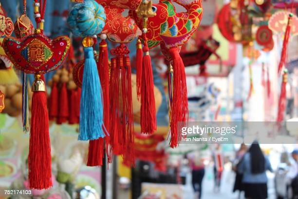 close-up of souvenirs hanging at market stall - chinatown stock pictures, royalty-free photos & images