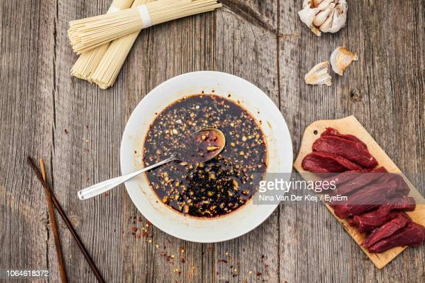 close-up of soy sauce in bowl on table - soy sauce stock photos and pictures