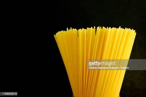 close-up of spaghetti against black background - pasta stock pictures, royalty-free photos & images