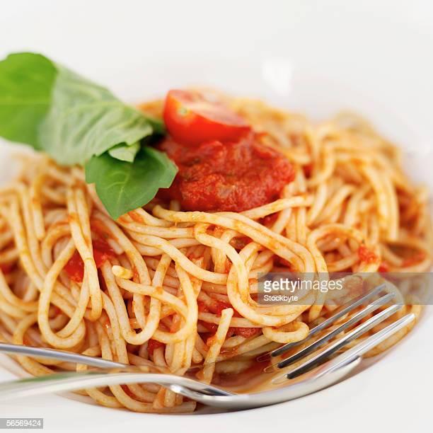 close-up of spaghetti garnished with basil
