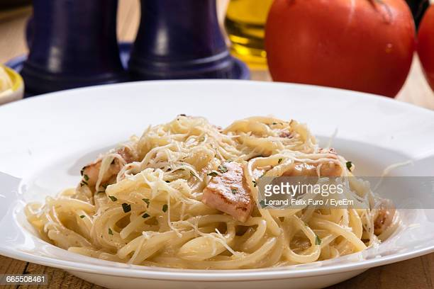 Close-Up Of Spaghetti With Carbonara In Plate On Table
