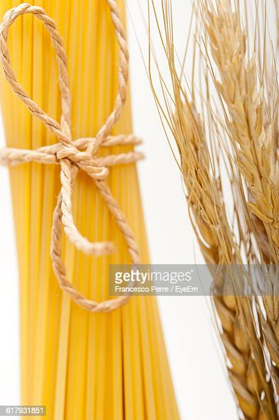 Close-Up Of Spaghetti With Wheat On Table