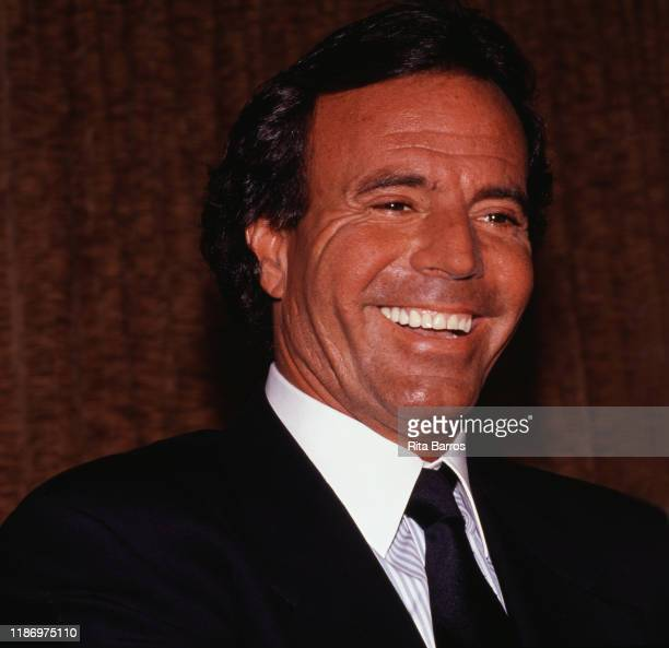 Closeup of Spanish Latin and Pop singer Julio Iglesias as he smiles during a press conference Estoril Sol Portugal July 19 1988