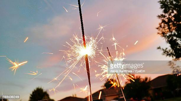 Close-Up Of Sparkler Against Sky During Sunset