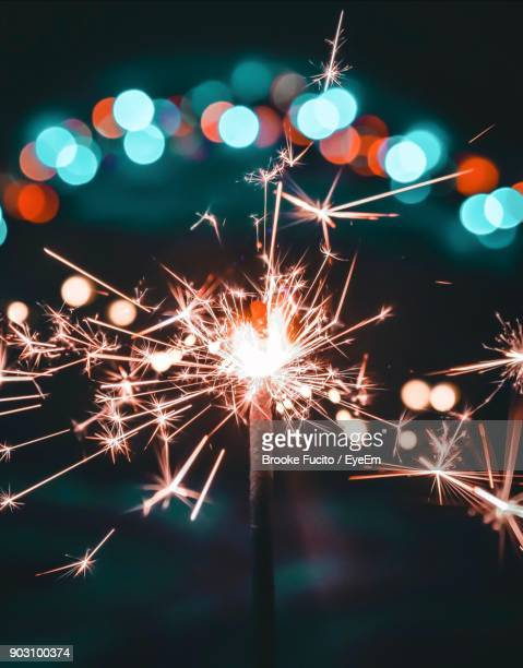 close-up of sparkler at night - diwali celebration stock photos and pictures