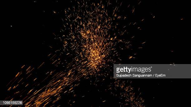 close-up of sparks against black background - sparks stock pictures, royalty-free photos & images