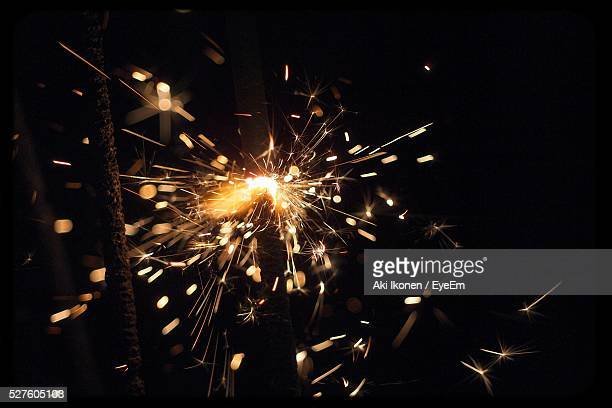 close-up of sparks at night - sparks stock pictures, royalty-free photos & images