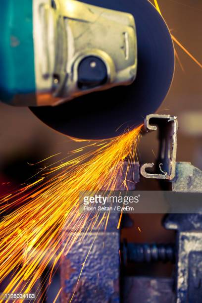 close-up of sparks emitting from circular saw - florin seitan stock pictures, royalty-free photos & images