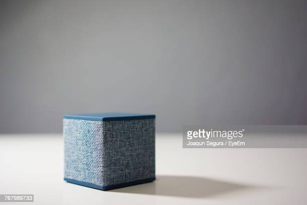close-up of speaker on table - bluetooth stock pictures, royalty-free photos & images