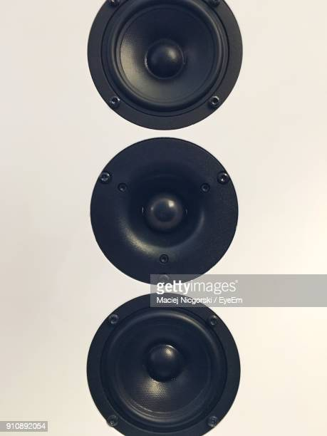 Close-Up Of Speakers Against White Background