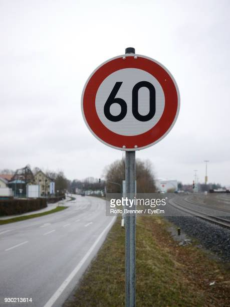 close-up of speed limit sign against sky - number 60 stock photos and pictures