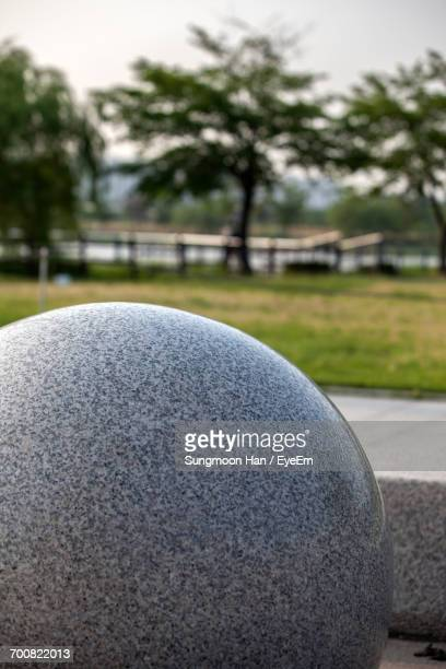 close-up of sphere shaped stone at park in city - bucheon stock pictures, royalty-free photos & images