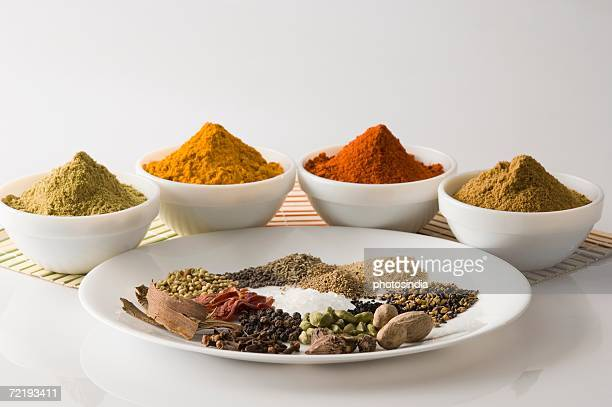 close-up of spices in bowl - garam masala stock photos and pictures