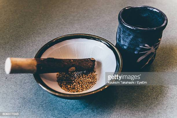 close-up of spices in mortar and pestle on table - koukichi ストックフォトと画像