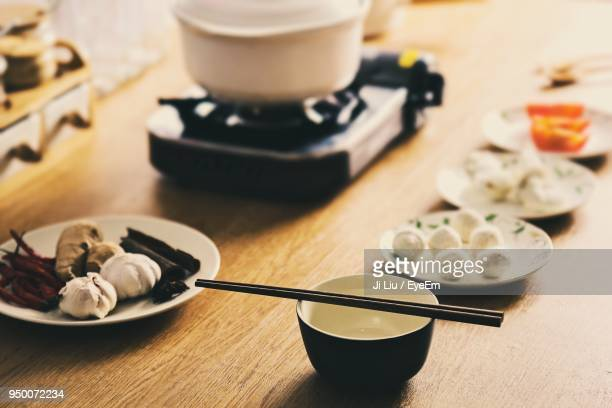 close-up of spices on wooden table - fuzhou stock pictures, royalty-free photos & images
