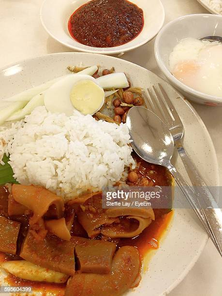 Close-Up Of Spicy Nasi Lemak Food In Plate