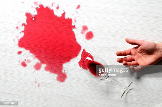 close-up of spilled red wine on the white floor, studio - spilling stock pictures, royalty-free photos & images