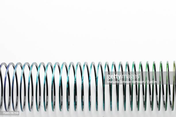 Close-Up Of Spiral Metal Against White Background