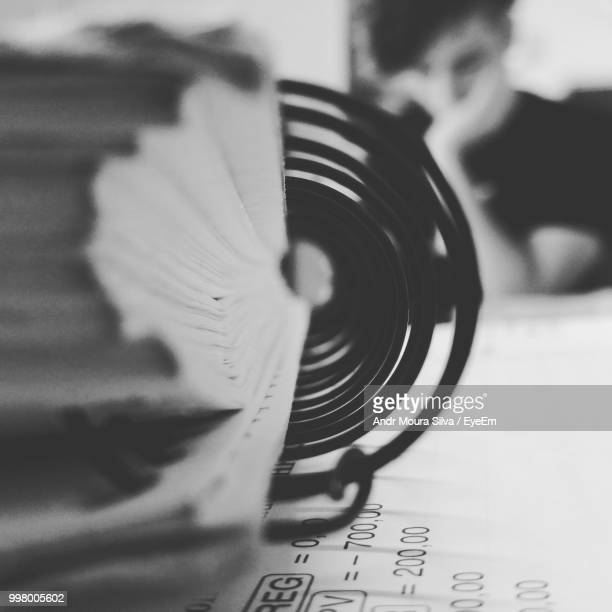 close-up of spiral notebook on table - moura stock photos and pictures