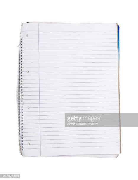 close-up of spiral notebook over white background - lined paper stock pictures, royalty-free photos & images