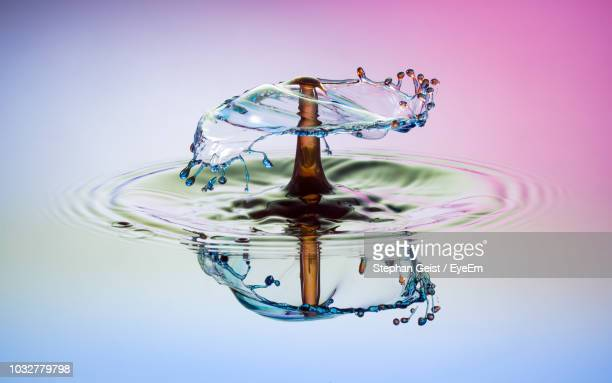 close-up of splashing water - slow motion stock pictures, royalty-free photos & images