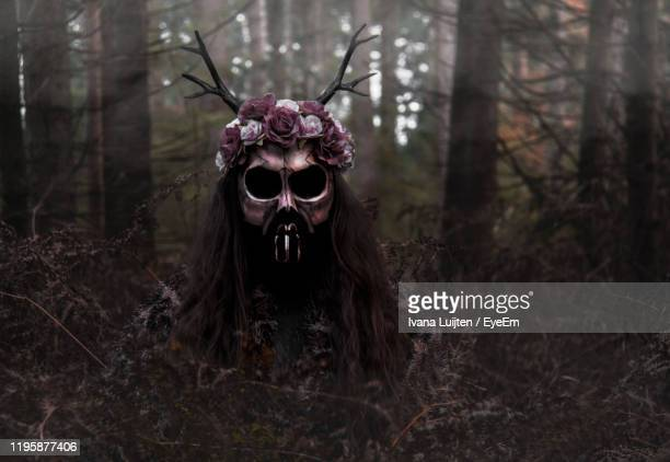 close-up of spooky halloween decorations on plants in forest - crown close up stock pictures, royalty-free photos & images