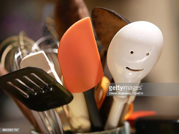 Close-Up Of Spoons And Spatulas In Kitchen