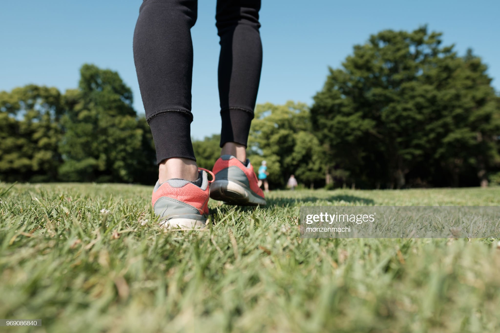 https://media.gettyimages.com/photos/closeup-of-sport-shoes-walking-on-grass-picture-id969086840?s=2048x2048