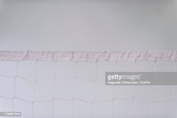 close-up of sports net against sky - cetkauskas stock pictures, royalty-free photos & images