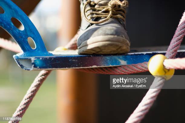 Close-Up Of Sports Shoe On Outdoor Play Equipment