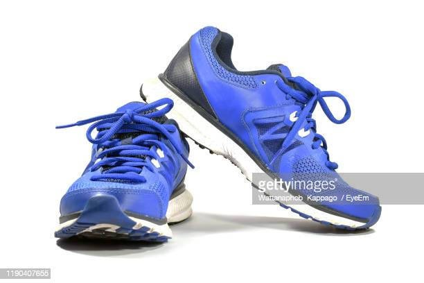 close-up of sports shoe on white background - blue shoe stock pictures, royalty-free photos & images