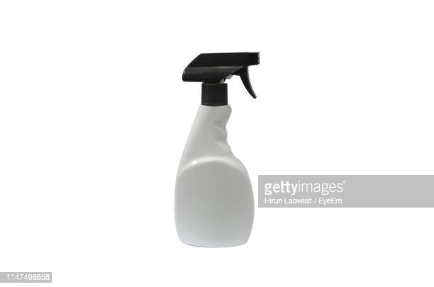 close-up of spray bottle against white background - spray bottle stock pictures, royalty-free photos & images
