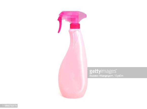 close-up of spray bottle on white background - spray bottle stock pictures, royalty-free photos & images