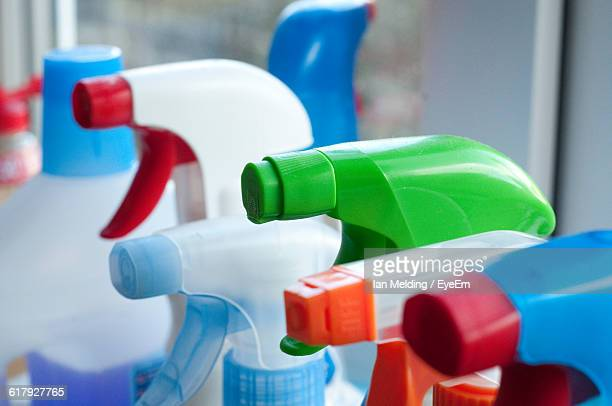 Close-Up Of Spray Bottles In Kitchen