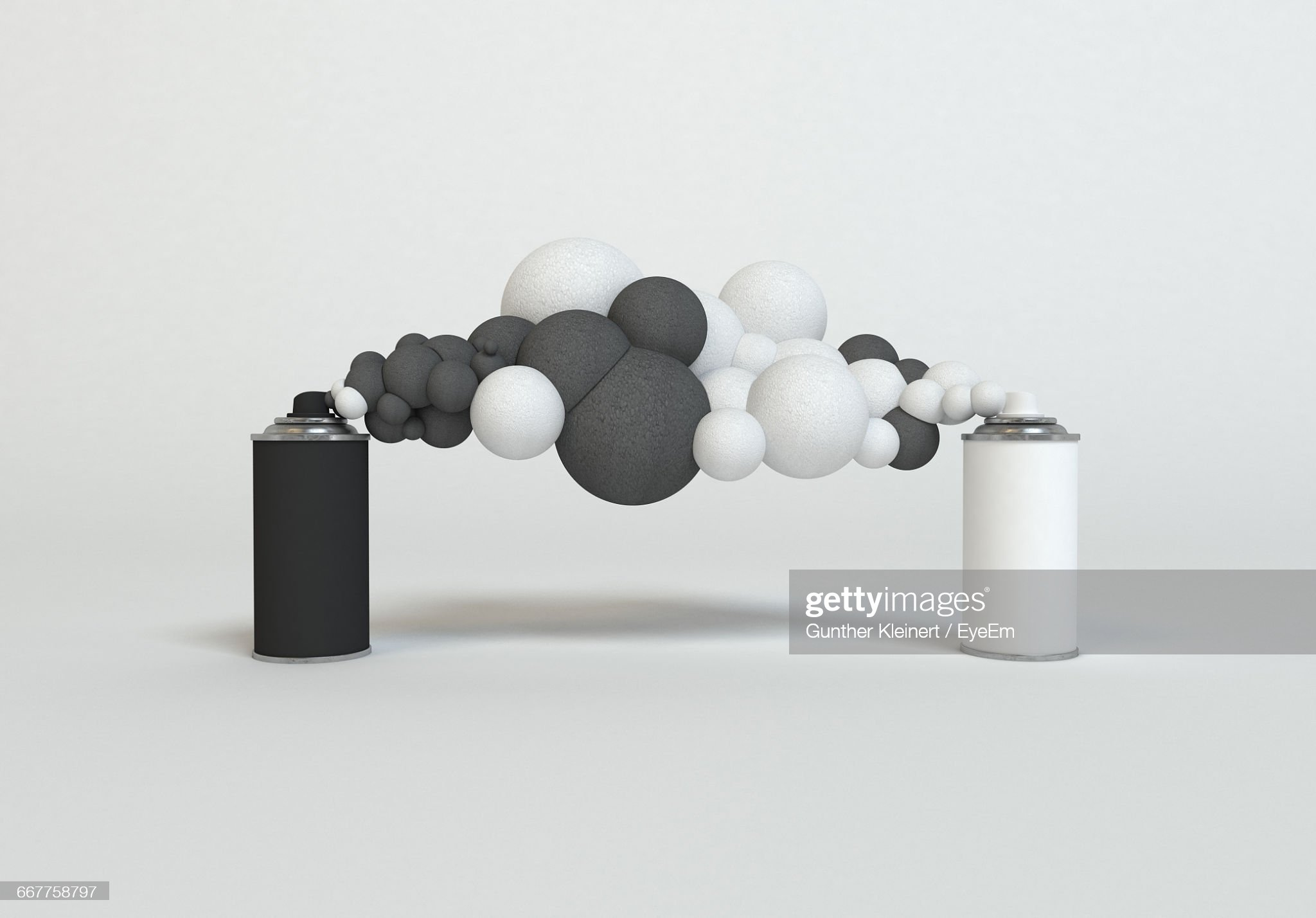Close-Up Of Spray Bottles With Black And White Foam : Stock Photo