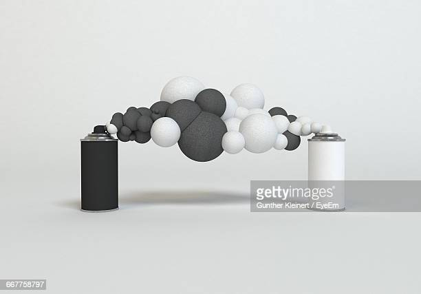 Close-Up Of Spray Bottles With Black And White Foam