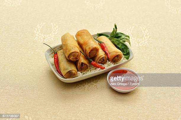 Close-Up Of Spring Rolls Served In Small Plate