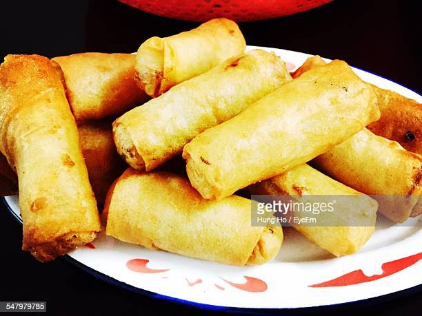 Close-Up Of Spring Rolls Served On Table