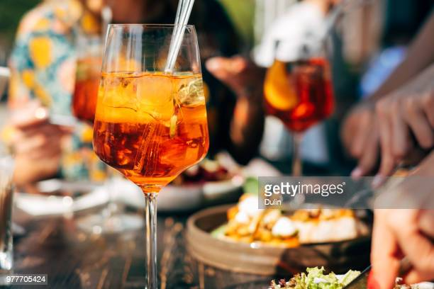 Close-up of Aperol spritz cocktails on a dinner table