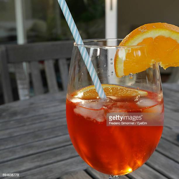 Close-Up Of Aperol Spritz In Wineglass On Table