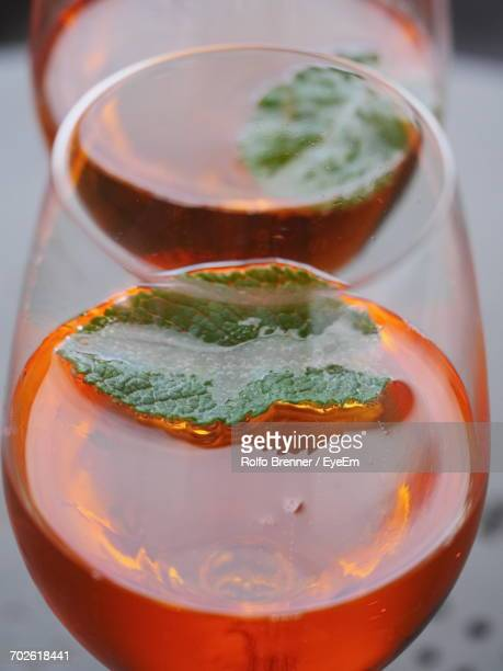 Close-Up Of Aperol Spritz Served In Glass On Table